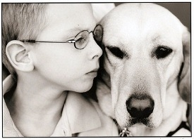 Boy with face pressed against Dog