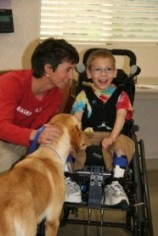 Boy in Wheelchair with Dog